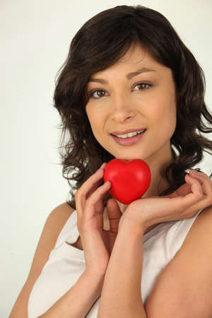 widespread: Brunette woman with heart in hand