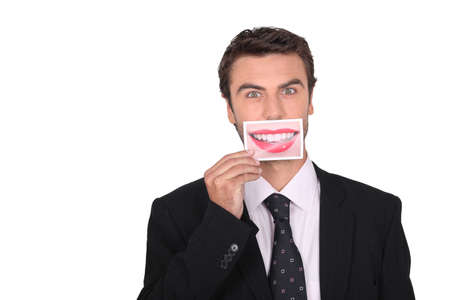 big mouth: Man holding a photograph of a woman