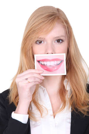 big mouth: Woman holding photo of mouth