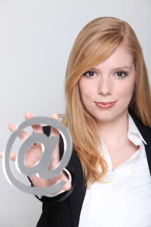 weblog: Pretty young businesswoman holding an @ sign