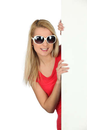 Woman in sunglasses with a blank board Stock Photo - 15154417