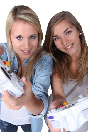 Teenage girls playing computer games photo