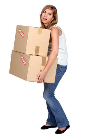 heavy lifting: Woman carrying boxes