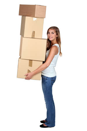 17 19 years: Young woman carrying boxes Stock Photo