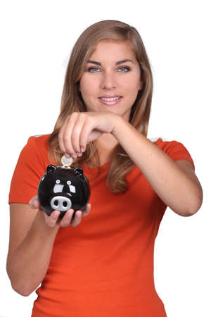 vested: Teenager holding piggy bank Stock Photo