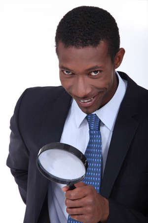 Businessman using magnifying glass Stock Photo - 15154429