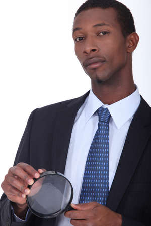 African American man in suit holding a loupe photo