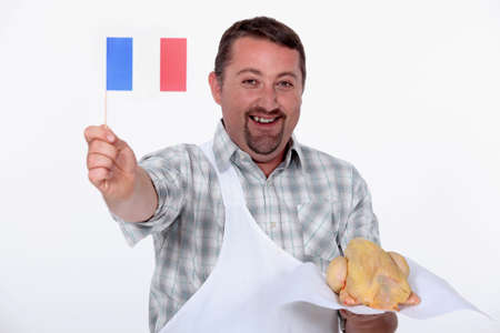capon: Frenchman proudly waving the flag over his uncooked French chicken