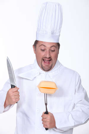 vengeful: Chef about to carve a polystyrene box Stock Photo