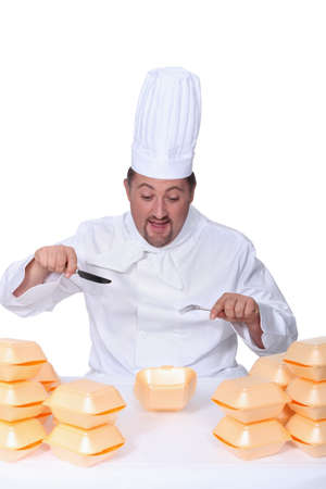 Chef surrounded by take-away packaging Stock Photo