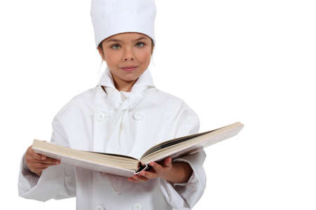 apparently: Girl dressed as a cook Stock Photo