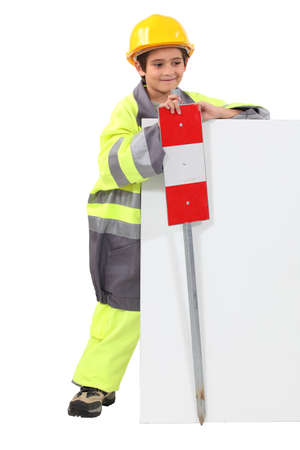 make belief: Child pretending to be a traffic guard