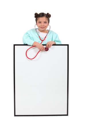 pediatra: Una ni�a que juega a ser m�dico