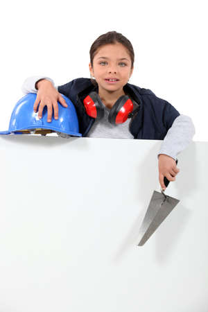 Little girl dressed as manual worker photo