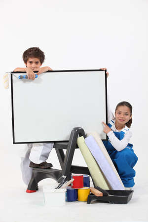art lessons: Two children pretending to be decorating