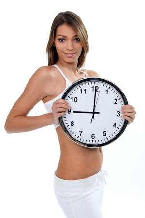 passing: Woman in white underwear with a clock showing 9 o