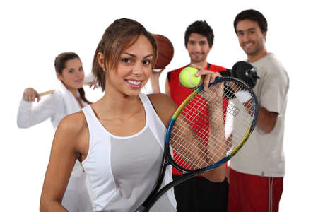 physical activity: Teenagers dressed for different sports Stock Photo