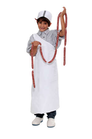 disguised: Boy dressed as a butcher