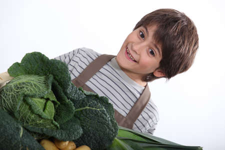 Young boy with a selection of fresh produce photo