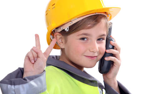 foreman: portrait of a little girl in construction clothes