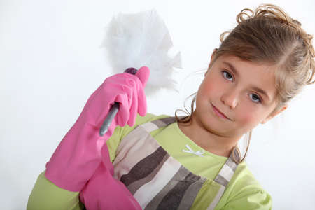 duster: Little girl with duster Stock Photo