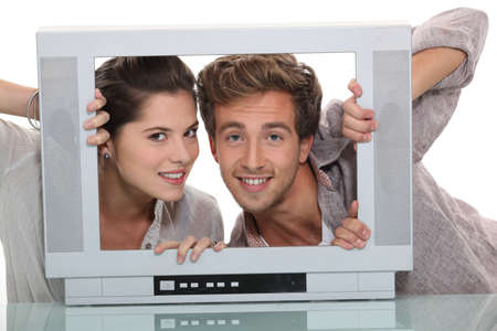 Couple in an empty television screen Stock Photo - 15154552