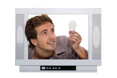 telly: Man fitting light bulb inside television