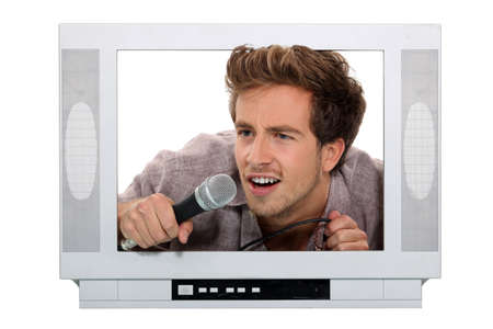 telly: young male tv host Stock Photo