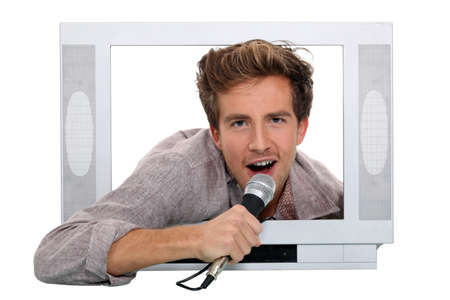 Man singing inside television photo