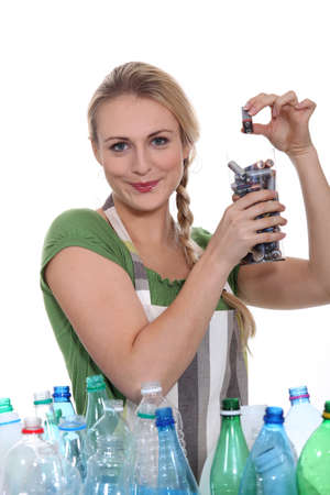 9v battery: Woman sorting the recycling Stock Photo