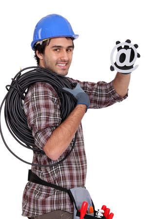 Electrician holding at symbol photo