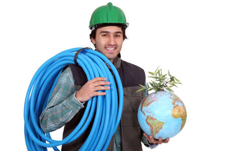 Construction worker holding corrugated tubing and a globe photo