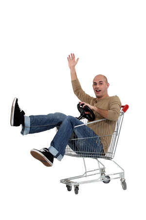 jesting: man driving a shopping cart
