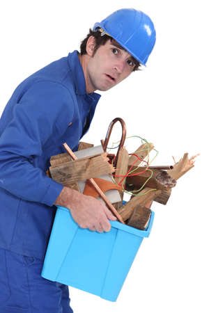 man carrying box: A weird man carrying scraps