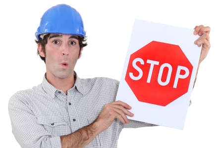 A road worker holding a stop sign  photo