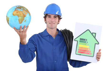 evoke: Workers with globe and energy rating panel Stock Photo
