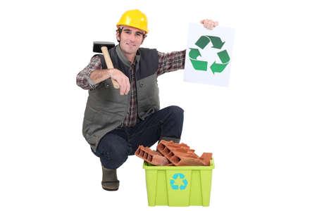 Builder recycling bricks Stock Photo - 15174613