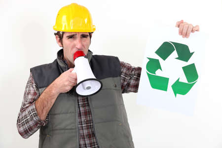 craftsman talking in loudspeaker showing recycling logo photo