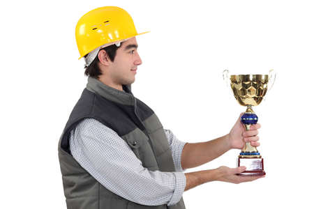 Construction worker with an award photo