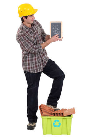 Tradesman writing on a chalkboard photo