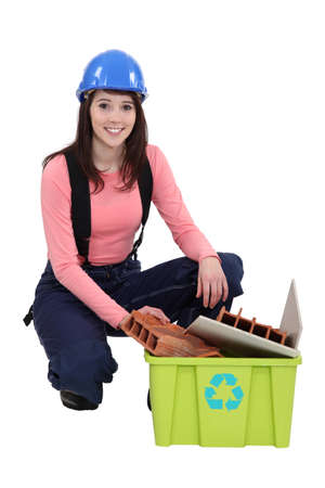 Builder kneeling by recyclable waste Stock Photo - 15174619