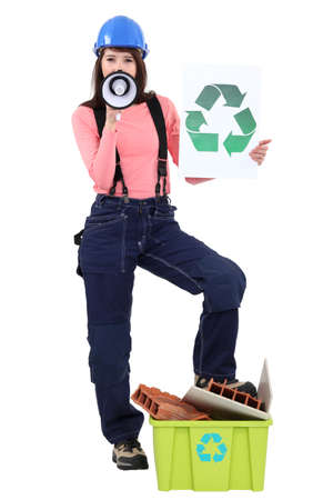 Construction worker calling on you to recycle material photo