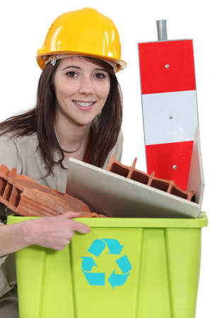 road worker: A female construction worker recycling scraps