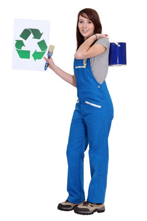 Painter holding up the recycling symbol photo