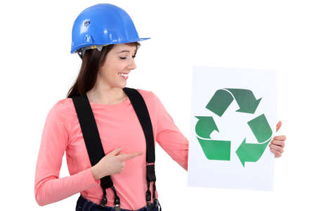 reusing: Builder pointing to recycle sign Stock Photo