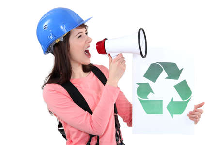 A female construction worker promoting recycling  photo