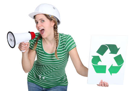 overseer: Female builder encouraging people to recycle Stock Photo