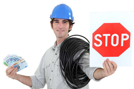 cost estimate: Electrician holding stop sign and cash