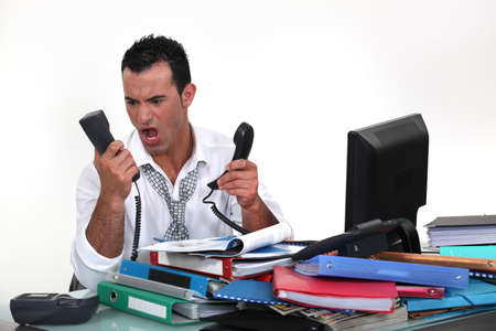 angriness: Overworked businessman Stock Photo
