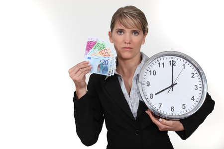 Woman with clock and notes in hand photo